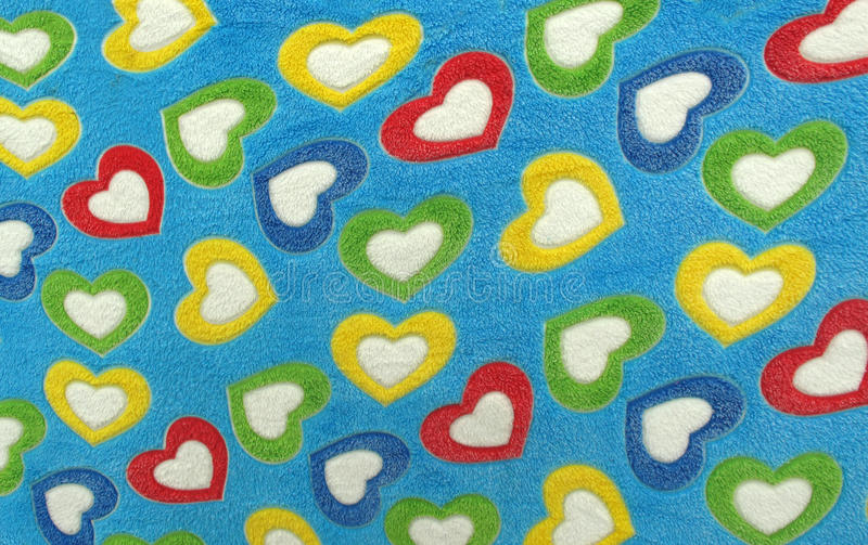 Blanket for love full of coloful hearts stock image