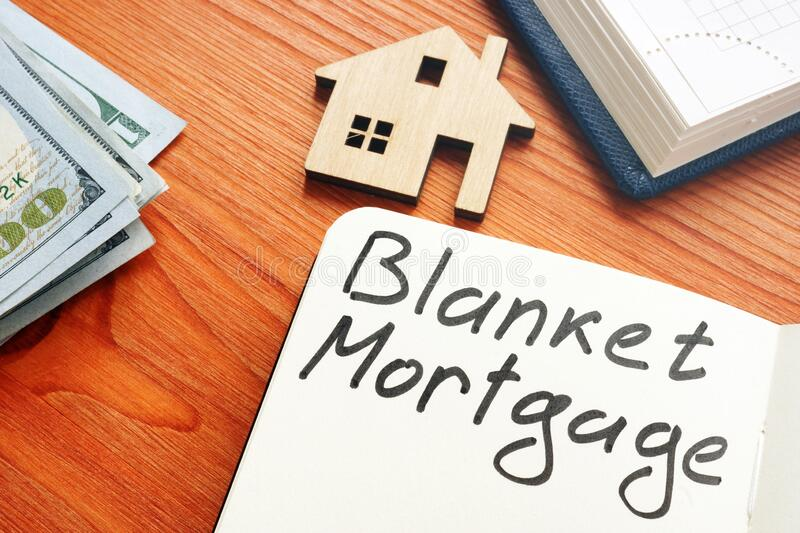Blanket mortgage written phrase and model of home. Blanket mortgage written phrase and model of house royalty free stock image