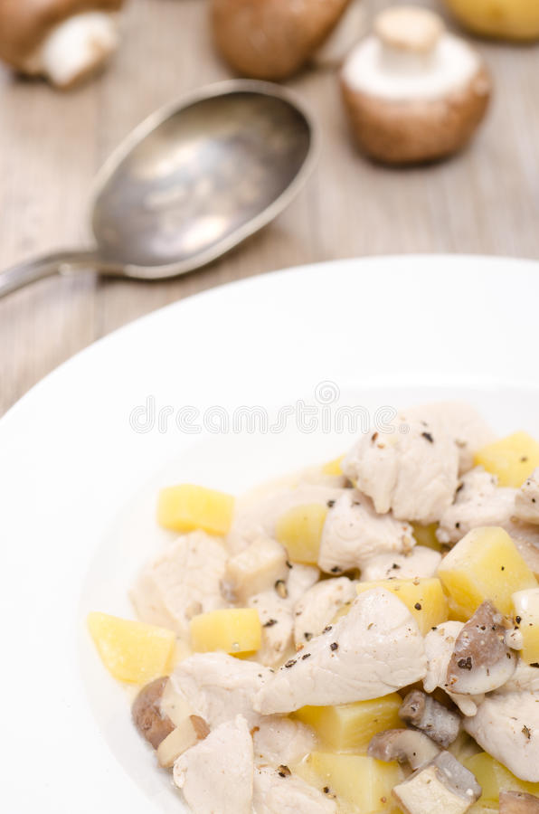 Blanquette from turkey with potatoes. In a white plate royalty free stock image