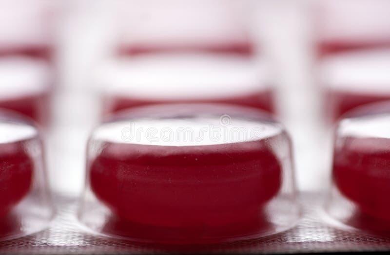 Blase der roten Tabletten lizenzfreies stockfoto