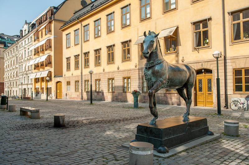 Blasieholmen square, Stockholm. Stockholm, Sweden - July 22, 2011: Blasieholmen square in the city center of Stockholm. A bronze horse inspired by the horses of royalty free stock photos