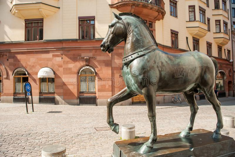 Blasieholmen square, Stockholm. Stockholm, Sweden - July 22, 2011: Blasieholmen square in the city center of Stockholm. A bronze horse inspired by the horses of stock photo
