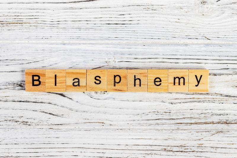 BLASPHEMY word made with wooden blocks concept stock images