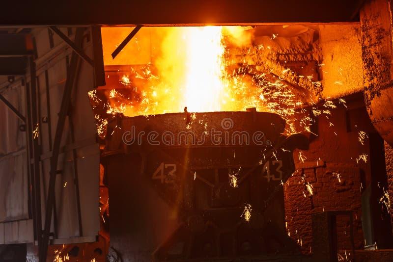 Blast furnace smelting liquid steel in steel mills. Scenario royalty free stock photography