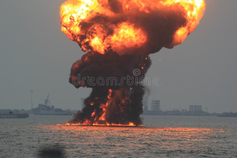 Blasting an oil rig royalty free stock images