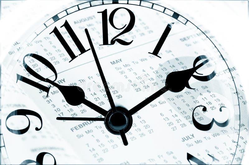 Blatt eines Kalenders mit der Zahl von Tagen und von Uhr stockbilder