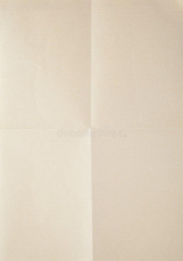 Blatt Papier gefaltet in vier stockfotografie