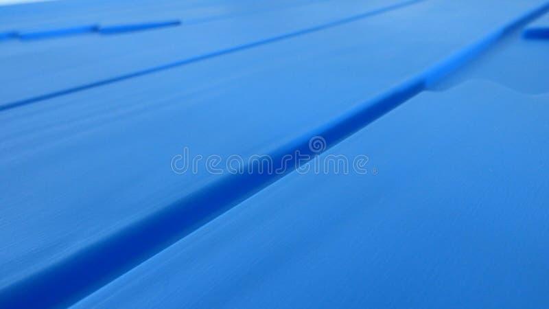 Blau schräg gelegener Hintergrund stockbild