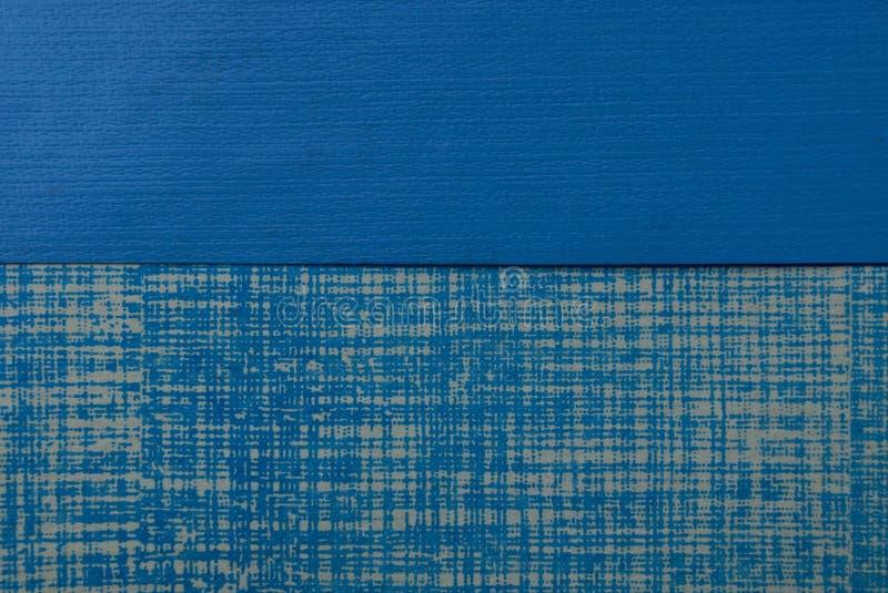 Blaue Beschaffenheit einer Plastikabdeckung und des Blattes Papier mit einem Muster lizenzfreie stockfotos
