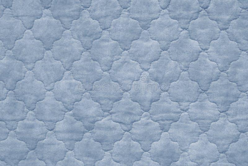 Blaue Bettdecke lizenzfreie stockfotos