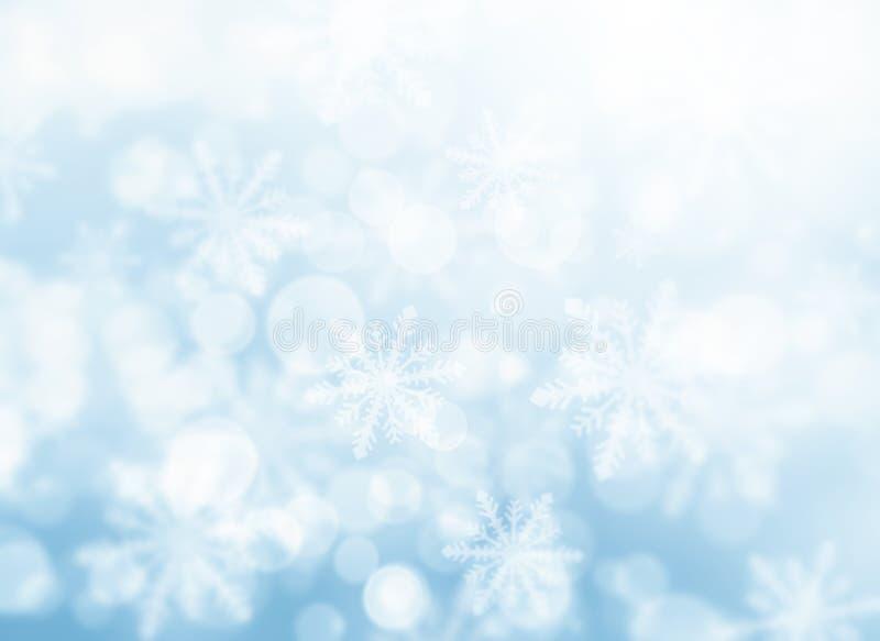 Blaue bokeh Schneeflocken stock abbildung
