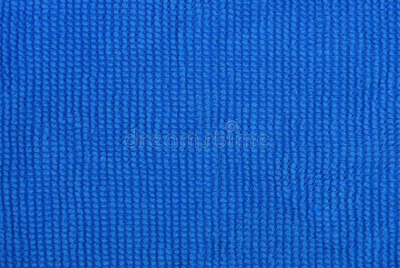 Blaue Gewebebeschaffenheit von einem Stück von microfiber Stoff stockbilder