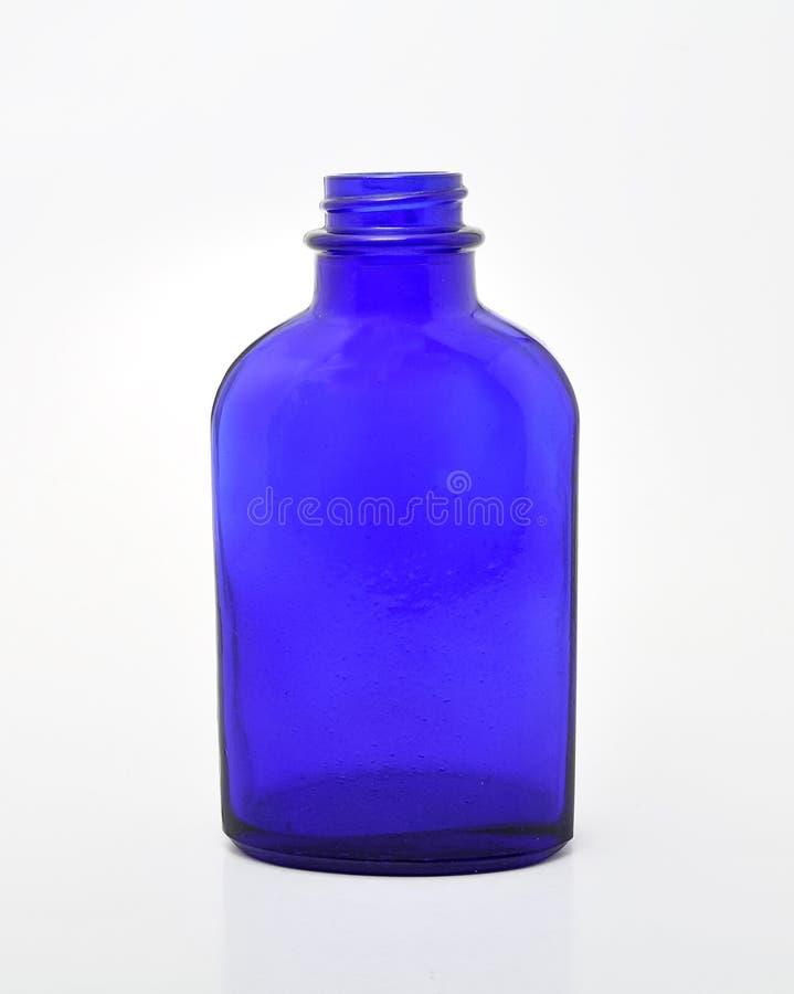 Blaue Glasflasche lizenzfreies stockbild
