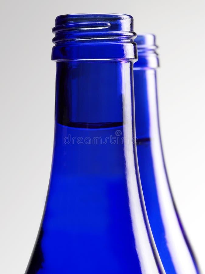 Blaue Glasflasche Soda lizenzfreies stockbild
