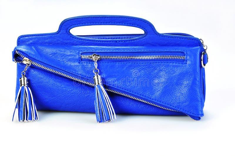 Blaue Ledertasche lokalisiert auf Weiß stockbild