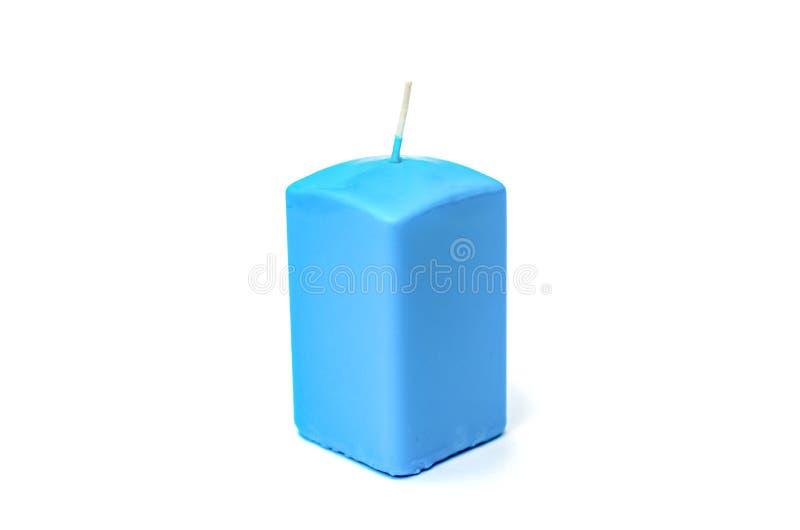 Blaue rechteckige Kerze für einen Feiertag stockbild