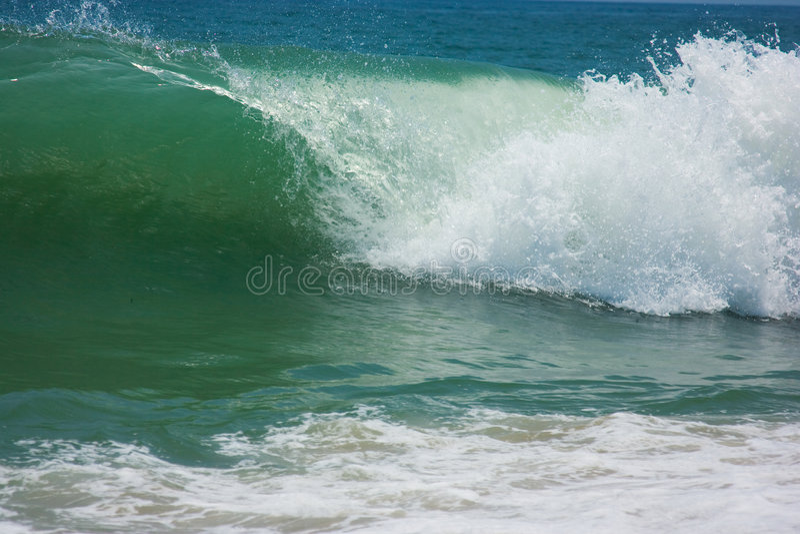 Blaue Strandwelle lizenzfreie stockbilder