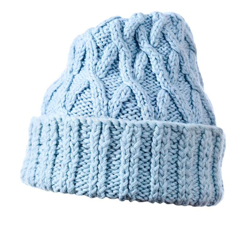 Blaue Strickmütze auf weißem Hintergrund stockfotografie