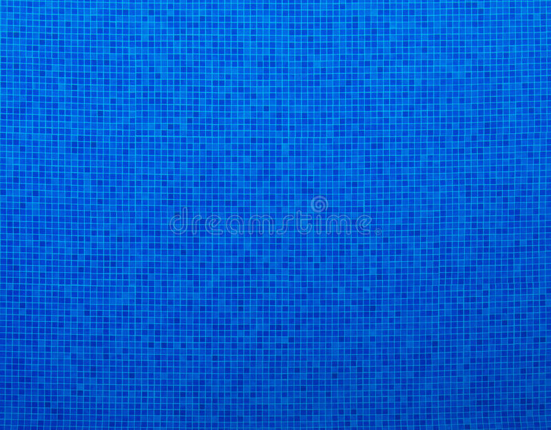 Blaue Swimmingpoolfliesen stockfoto