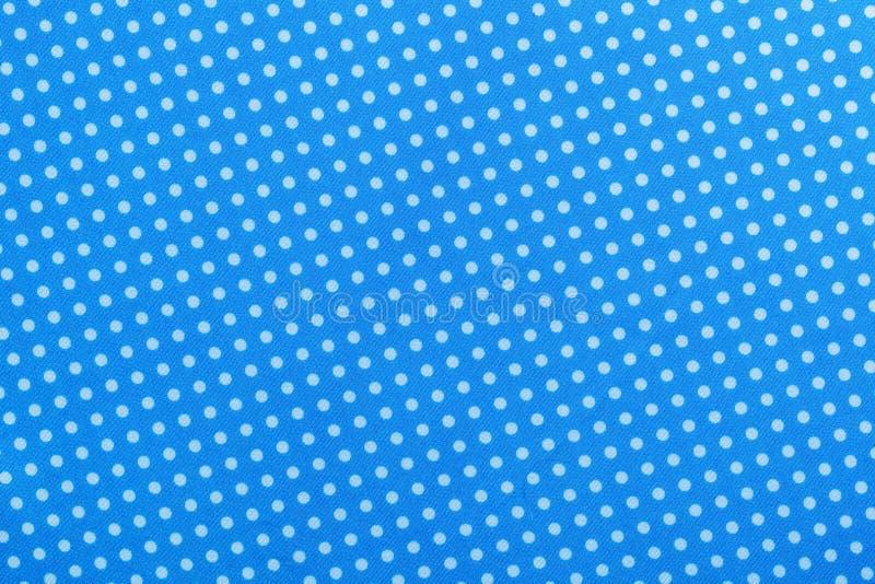Blaue Tupfenbaumwolltischdecke direkt oben stock abbildung