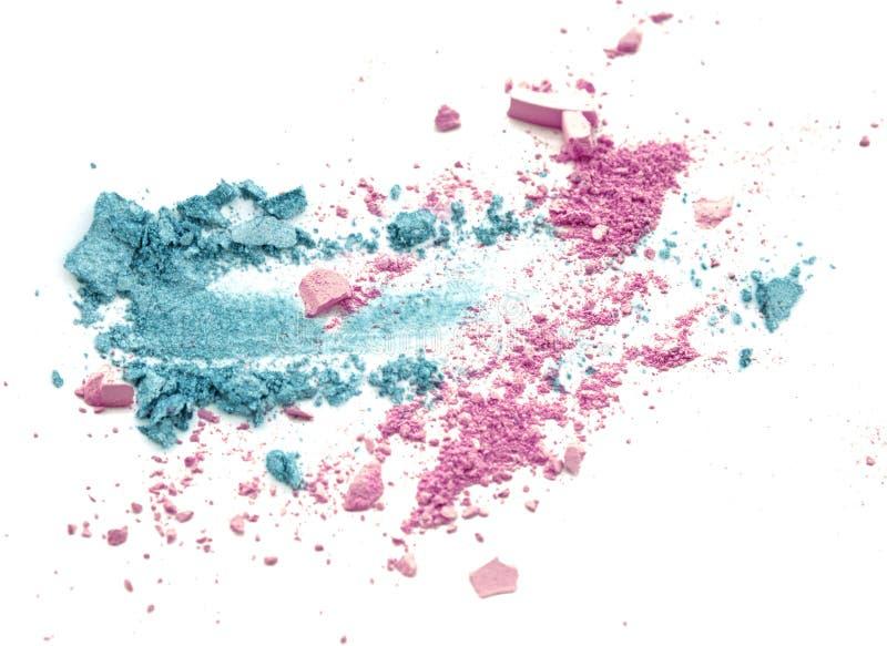 Blaue und rosa Farbe bilden den zerquetschten Pulverlidschatten stockbild