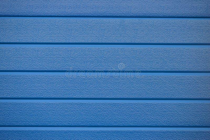 Blaue Wandbeschaffenheits-Hintergrundzusammenfassung stockbild