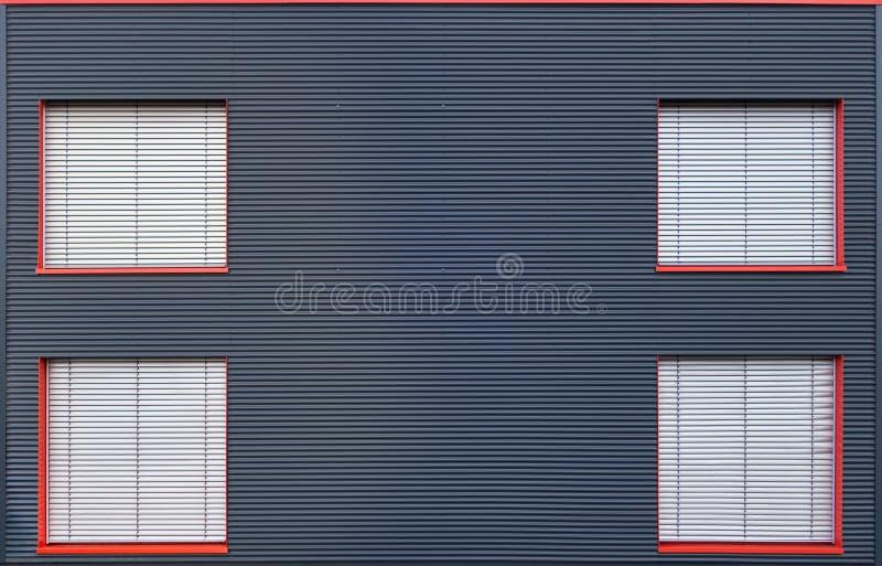 blaue wellblechfassade mit vier schloss fenster stockfoto bild von vier drau en 48657470. Black Bedroom Furniture Sets. Home Design Ideas