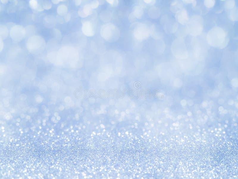Blauer abstrakter Funkelnhintergrund mit bokeh heller bokeh Urlaubspartyhintergrund für Weihnachts- und Sylvesterabend-Hintergrun stockfotografie