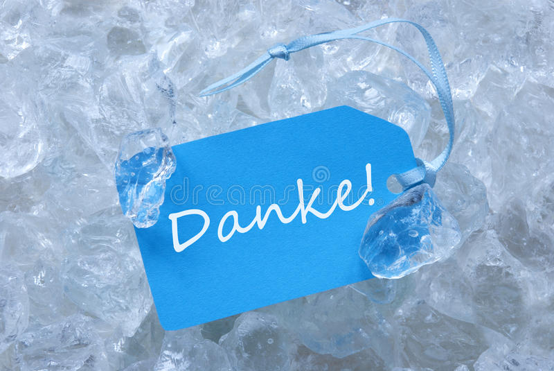 Blauer Aufkleber auf Eis mit Danke-Durchschnitten danken Ihnen stockbild