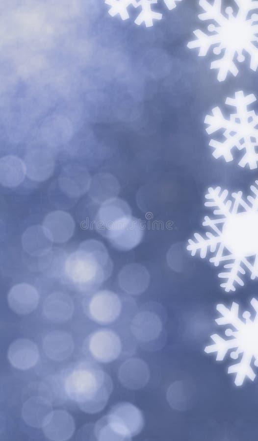Blauer bokeh Hintergrund mit Schneeflocken lizenzfreie abbildung