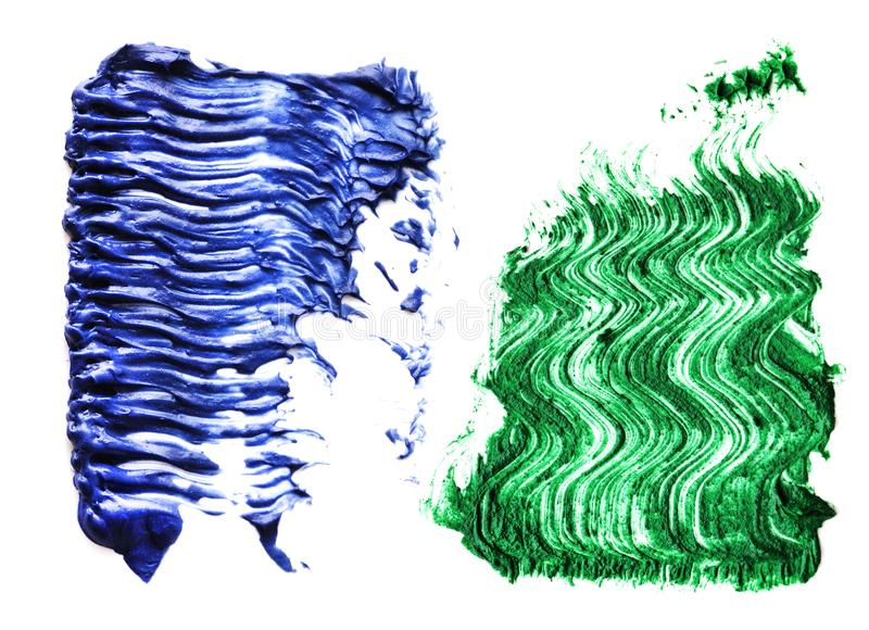 Blauer grüne Farbewimperntuschenbürstenanschlag auf Hintergrund stockbilder