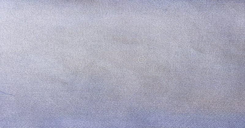 Blauer Hintergrund, Denimjeanshintergrund Jeans masern, Denimgewebe stockbild