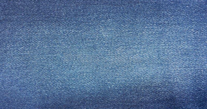 Blauer Hintergrund, Denimjeanshintergrund Jeans masern, Denimgewebe lizenzfreie stockfotos