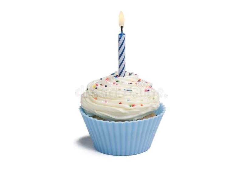 Blauer kleiner Kuchen und Kerze lizenzfreie stockfotos