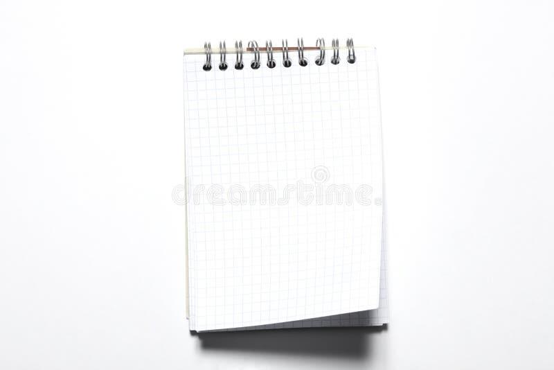 Blauer Notizblock isoliert auf weißem Hintergrund mit Kopierraum für Ihren Text lizenzfreie stockfotos