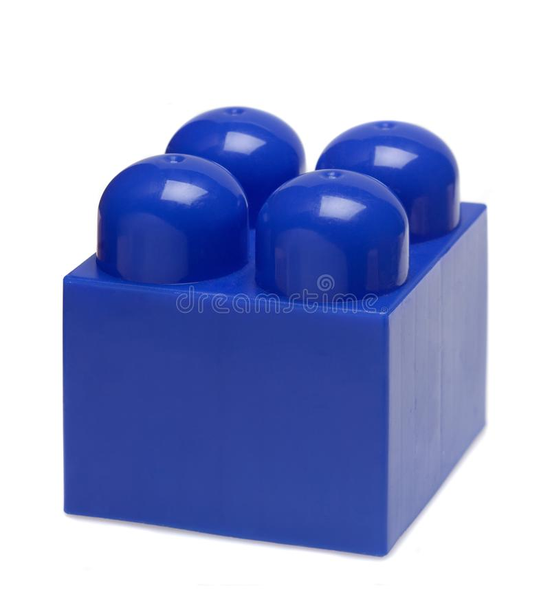 Blauer PlastikBauklotz Lokalisiert auf weißem Konzept lizenzfreie stockfotografie