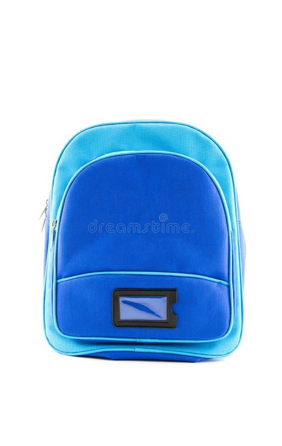 Blauer Rucksack mit dem Schulbedarf lokalisiert stockfoto