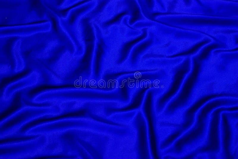 Blauer Satinhintergrund lizenzfreie stockbilder