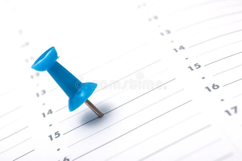 blauer Stift in der Tagesordnung lizenzfreies stockfoto
