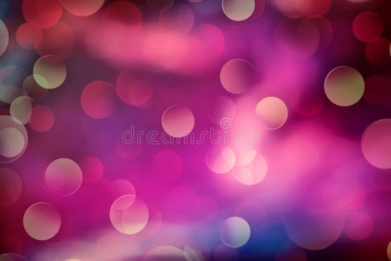 Blauer und purpurroter bokeh Hintergrund stockbild