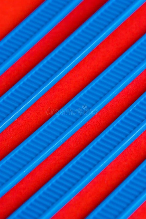 Blauer und roter Auszug stockbild