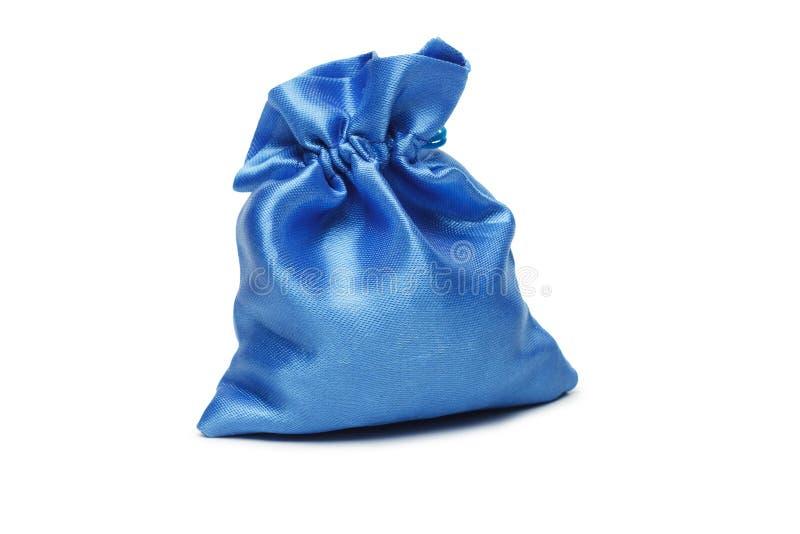 Blauer Weihnachtsbeutel mit Geschenk stockbilder
