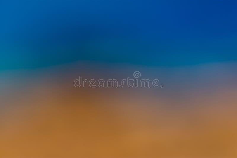 Blaues, aquamarines, orange und braunes glattes eine unscharfe Tapete/ein Hintergrund lizenzfreie stockfotografie