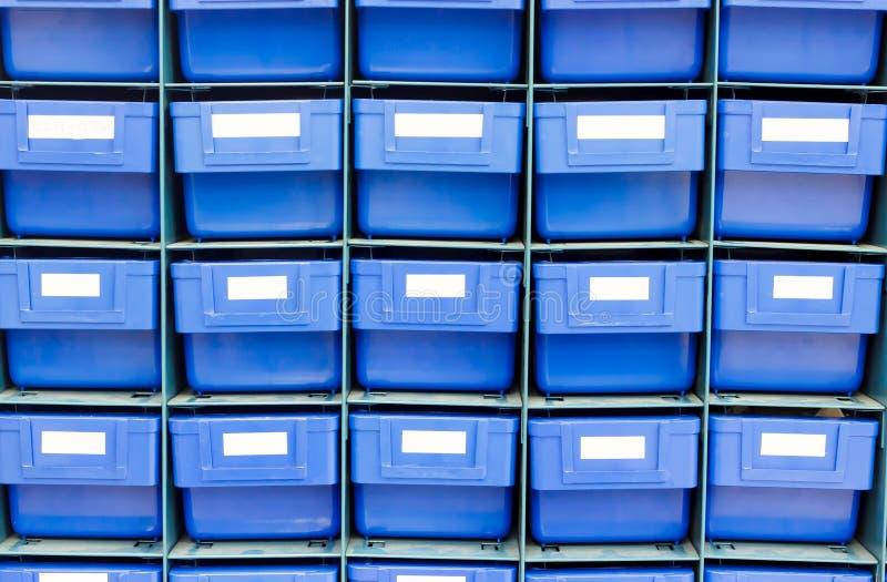 Blaues Fach für halten Ausrüstung stockfotos