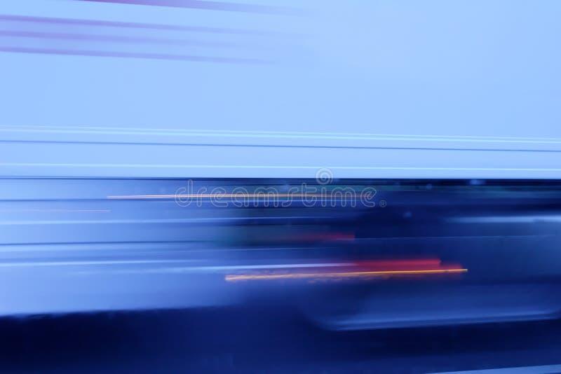 Blaues helles Unschärfe mit rotem Akzent lizenzfreie stockfotos