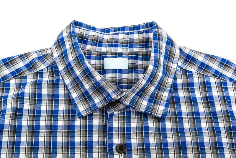 Blaues kariertes Hemd auf weißem Hintergrund stockbild