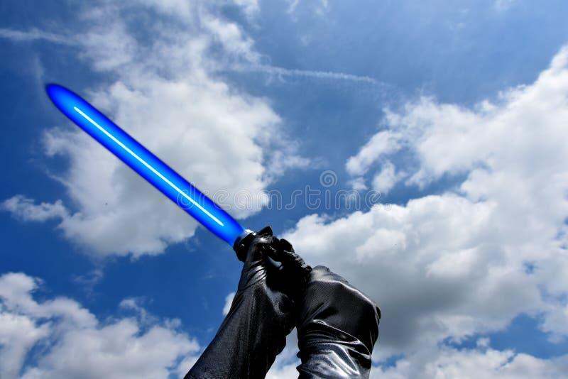 Blaues lightsaber stockbild