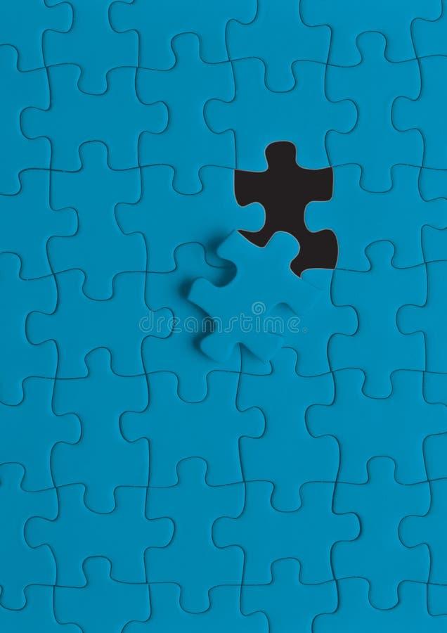 Blaues Puzzlespiel  lizenzfreie abbildung