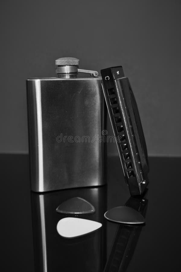 Blauharfe, Auswahl und Hüftenflasche lizenzfreie stockfotografie