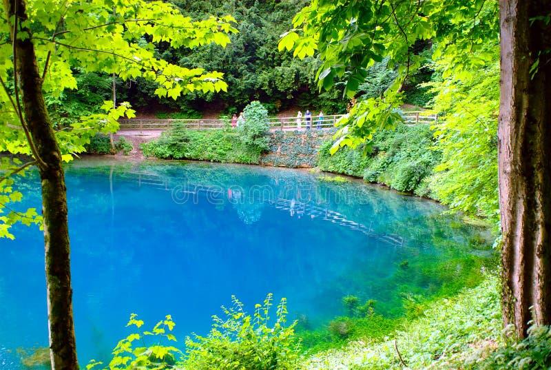 Blautopf Spring Pond. The Blautopf spring pond in Blaubeuren, near Ulm, South-Germany stock images